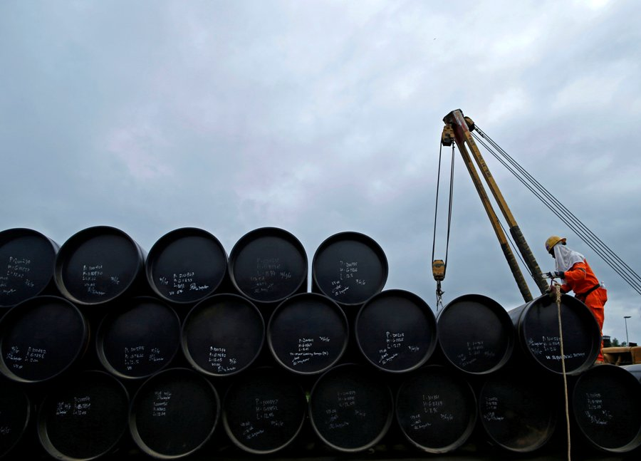 Oil slips amid trader caution before data releases