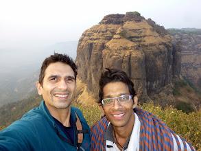 Photo: Bhatoba Pinnacle summit shot of Sunny Jamshedji and Ajit Bobhate with the Mahuli Fort in the background.