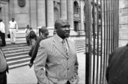 VICTIM: Siphiwe Mlaba leaving the Johannesburg high court after testifying how the men accused of killing reggae star Lucky Dube had hijacked him. 05/02/09. Pic. Vathiswa Ruselo. © Sowetan.