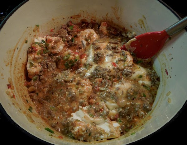 Next, add 16 ounces of softened cream cheese, the white queso dip and 1...