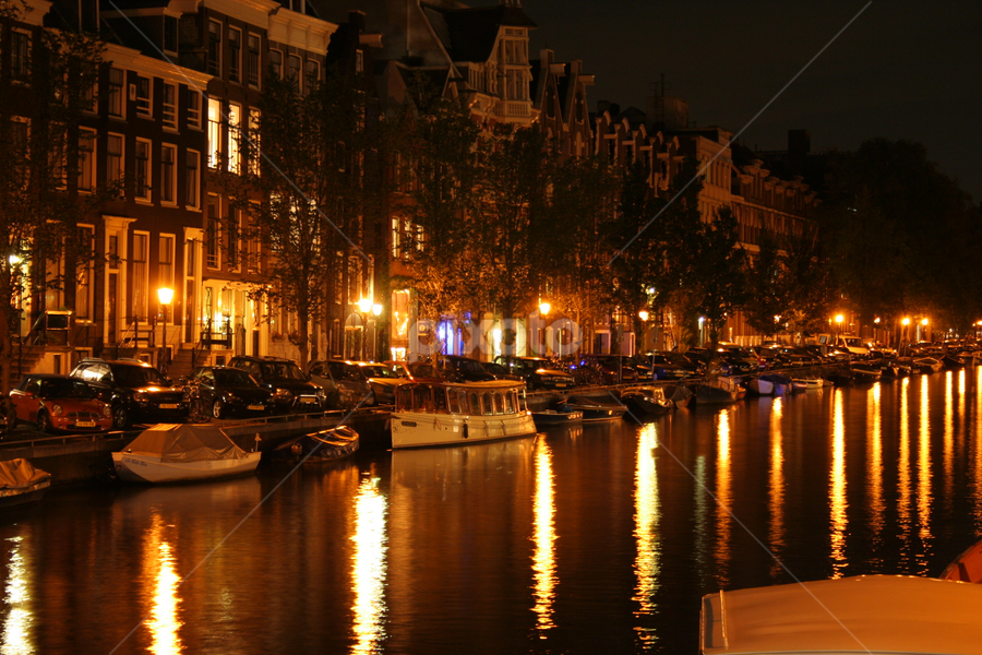 Amsterdam Water Life by Byron Anderson - City,  Street & Park  Neighborhoods ( water, boats, reflections, night, amsterdam )