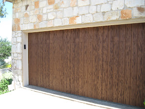 """Photo: A 16 x 7 door with a Pecky Cypress style wood. This is done in the factory Walnut color. the door is the vertical panel only """"San Jose"""" pattern."""