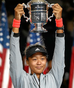 Calm and collected: Naomi Osaka hoists the trophy after her historic win at the US Open. Picture: JULIAN FINNEY/GETTY IMAGES