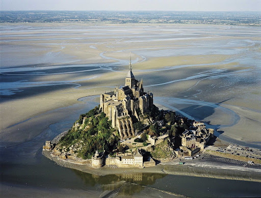 Aerial of historic Mont Saint Michel in Normandy, a UNESCO World Heritage site. It's accessible only when the tides recede.