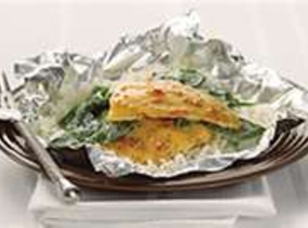 Bake until spinach wilts and the fish is just cooked through..about 10 minutes. ...