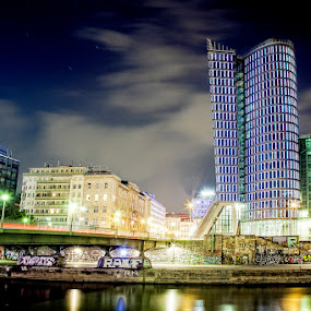 Uniqa Tower Vienna by Robert Luca - Landscapes Starscapes ( uniqa tower vienna illuminated night clouds lights )