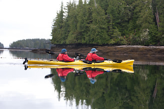 Photo: A quiet moment on the water, and a chance to grab a reflection shot as Caroline and Rick paddle by.