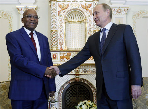 Russian President Vladimir Putin (R) shakes hands with his South African counterpart Jacob Zuma during their meeting at the Novo-Ogaryovo state residence outside Moscow, Russia. Photo credit: EPA