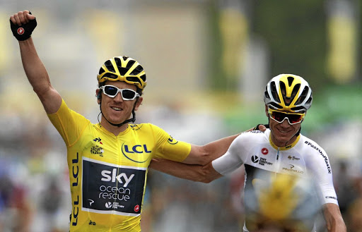 No doubting it's Thomas: Geraint Thomas, left, celebrates his Tour de France victory with Sky teammate Chris Froome in Paris on Sunday. Picture: REUTERS