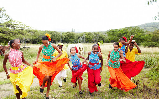 Local children in traditional colorful garb in Bonaire.