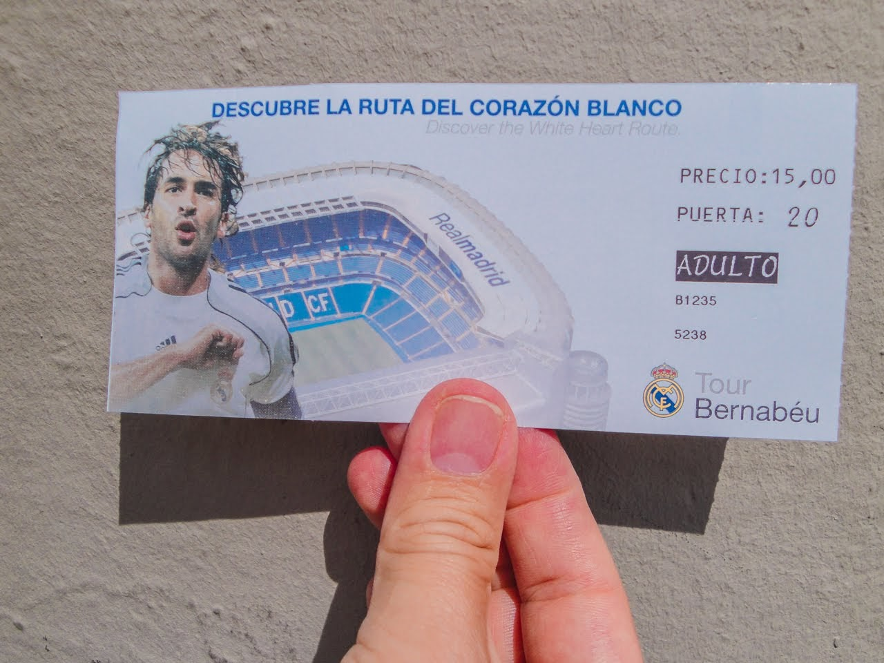 Holding up a ticket for the Tour Bernabéu