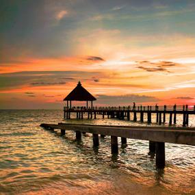 Sun will be rest soon by Arik S. Mintorogo - Landscapes Sunsets & Sunrises ( water, port, chairs, beach, bridge, sun )