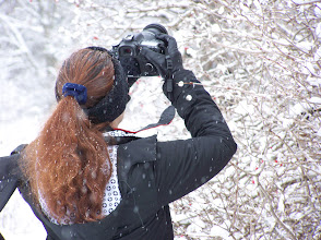 Photo: Rhonda taking a shot of snow covered tree branches.