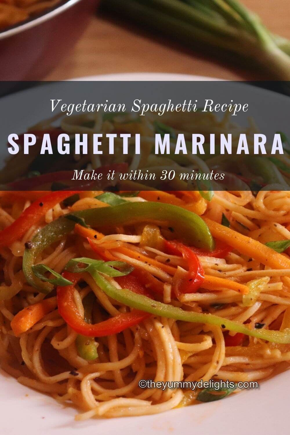 close up image of spaghetti marinara served in a white plate. This vegetarian spaghetti is garnished with spring onion greens