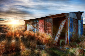 Photo: The Safehouse -   Today's photo is from a forgotten field in the south of Argentina, not too far from Ushuaia.  There was a housing community near here that was built then abandoned when the lake level started to rise.  It was full of old husks of structures that were still beautiful in their own way (and doubly so at sunset). -   From the blog at www.stuckincustoms.com