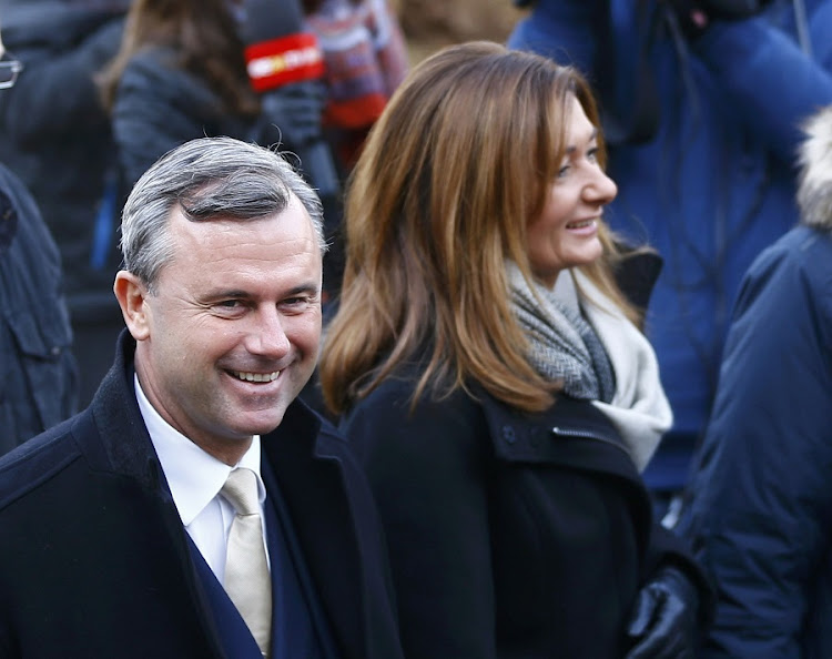 Austrian far-right Freedom Party presidential candidate Norbert Hofer and his wife Verena arrive in front of a polling station to cast their vote in Pinkafeld, Austria, on Sunday. Picture: REUTERS/Leonhard Foeger