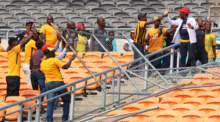Angry fans destroy a perimeter fence after their team Kaizer Chiefs were beaten 3-0 at home by visiting Chippa United in an Absa Premiership match at FNB Stadium on Saturday April 7 2018.