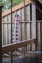 Photo: Set the beams on wall jacks and tacked 2x6 to the opposite side to keep the beam from falling foward as it went up.