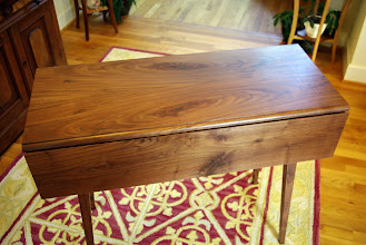 Photo: Walnut Shaker style drop-leaf table. Beautiful and versatile, this table is only 14 inches deep with leaves down and quite unobtrusive.  But, when you need a bigger workspace, it expands to 28 inches with both leaves up.  36 inches wide and 29 inches high.