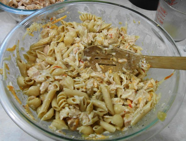 Pour liquid into bowl with pasta and mix well.