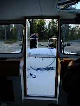 Photo: Juha and Anne pulling the boat into shore