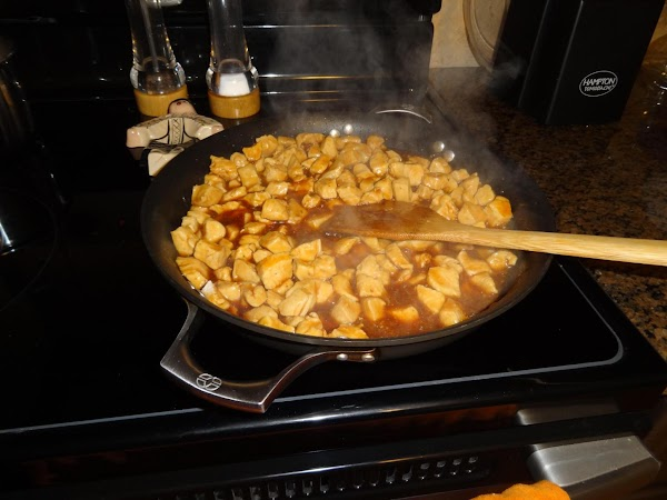 Cover pan with cooking spray.  Add cubed chicken and cook on med-high until...