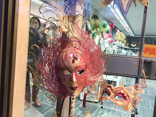 Venice-womans-mask.jpg - A woman's mask in the traditional Venetian style in a shop window along the Procuratie Vecchie on Piazza San Marco, Venice.