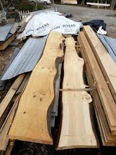 Photo: Pine slabs for kitchen S. sill/counter, living room sill noses; shading device slats & supports to the right.