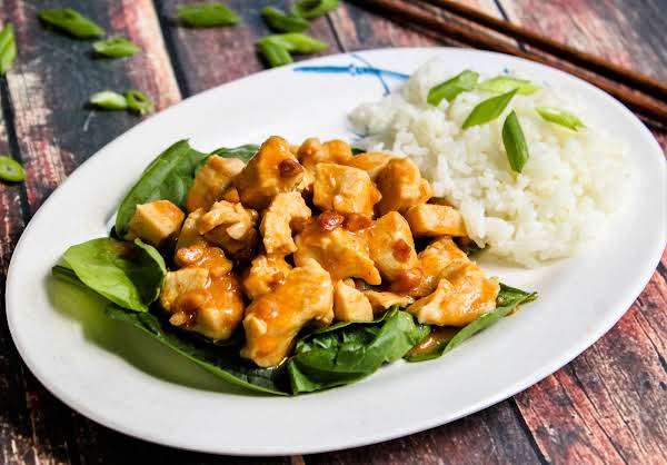 Chicken Rama In Thai Peanut Sauce Over Spinach.