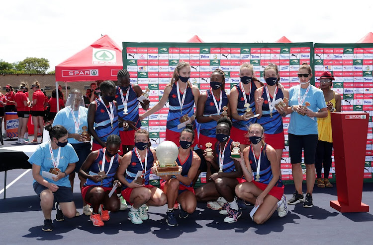 Tshwane players and officials celebrate with the Spar National Netball Championships trophy after they defeated Dr Kenneth Kaunda 44-39 in the final in Bela-Bela on Saturday.
