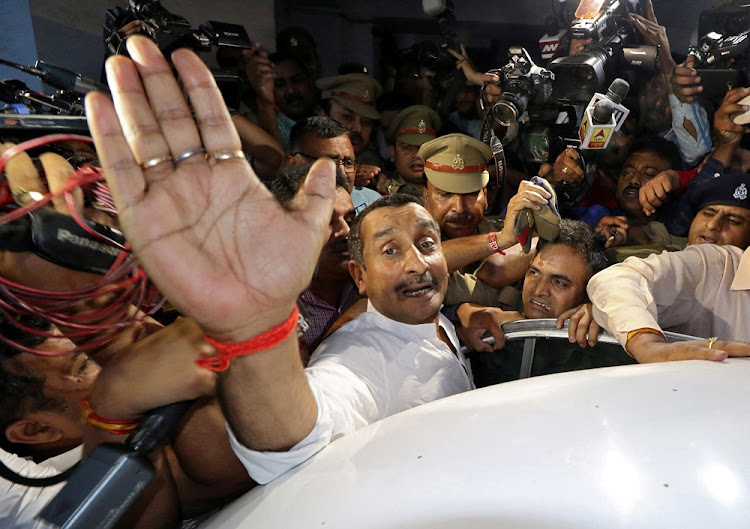 Kuldeep Singh Sengar, a legislator of Uttar Pradesh state from India's ruling Bharatiya Janata Party, reacts as he leaves a court after he was arrested on Friday in connection with the rape of a teenager, in Lucknow, India, April 14, 2018.