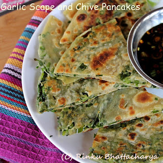 Chive, Scallion and Garlic Scape Pancakes with a Dipping Sauce.