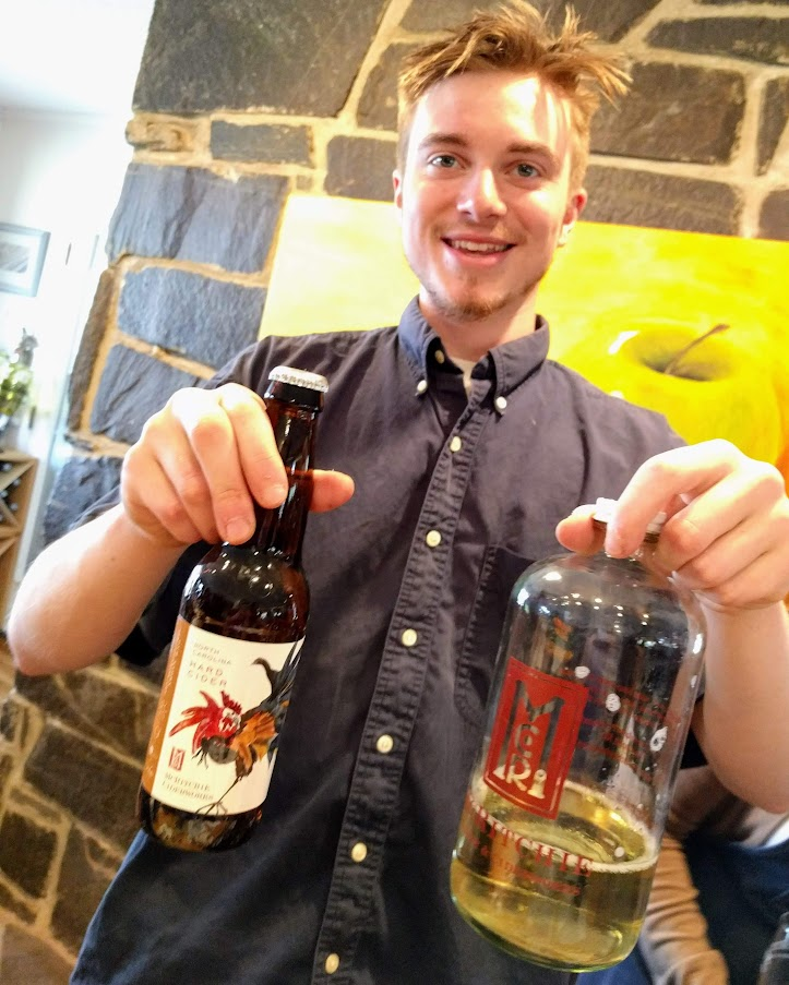 Son Asher McRitchie displays cider choices