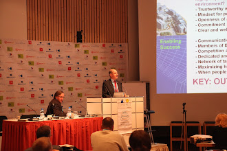 "Photo: ""Communicating Science & Innovations"" Panel - 2012: James Gillies - moderator, Hans Kunz - presenting"