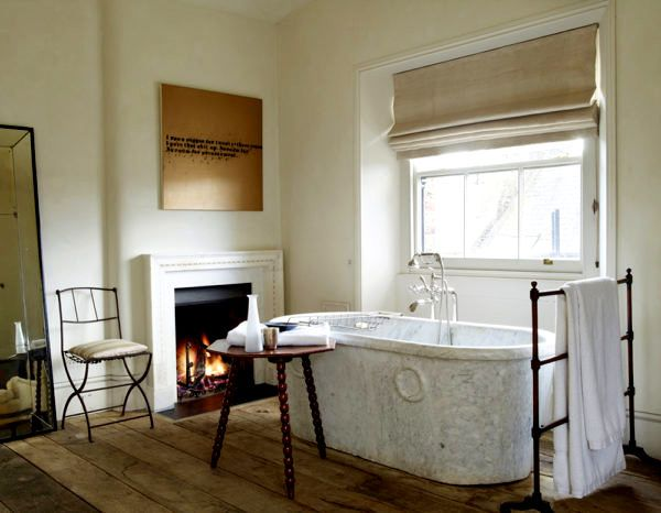 Luxurious bathroom with fireplace. Rose Uniacke's Classic Designed Minimal Home in London.