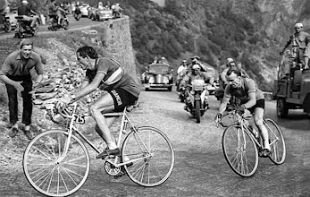 Photo: Fausto Coppi of Italy leads the pack ahead of Jean Robic of France on his way to win the 10th stage of the Tour de France cycling race from Lausanne to L'Alpe d'Huez, July 4, 1952. Coppi later won the Tour de France 1952. (AP Photo)    -----    Der Italiener Fausto Coppi uebernimmt waehrend des Aufstiegs nach Alpe d'Huez bei der Tour de France 1952 vor dem Franzosen Robic die Fuehrung. Coppi gewinnt die Tour de France 1952.  (AP Photo)