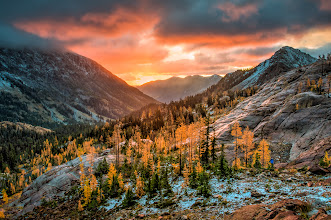 Photo: Sunrise on the Larches  When the sun comes up and hits the larches they glow like they're on fire.  Lest anyone believe +Jake Johnsonthat I may have slept through this sunrise I present evidence that it wasn't the case. I will admit that this particular morning I wasn't the quickest out of bed as the night had been a long, cold and windy one. After leaving the warmth of my sleeping bag I was out bounding around the rocks like one of the mountain goats to try and find the best vantage point. You can see Jake's choice of view points as he is standing in my photo center right in the blue jacket.  Prints available:http://bit.ly/1txHXTm  #sunrise  #larches  #washington  #photography