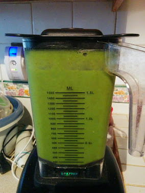 Blender with the final smoothie, it is very green