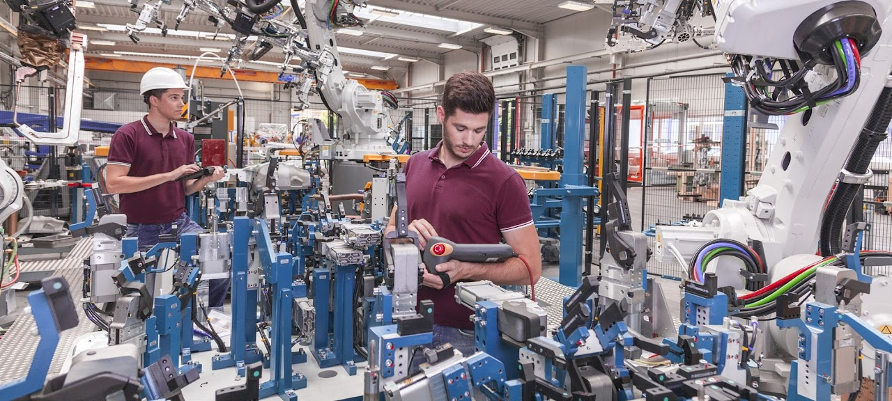 Figure 2. Cobots working alongside humans in a factory environment