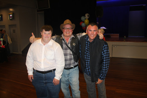 Terry Watson, disability support coordinator Justin Thompson and Michael Octigan celebrating in style at the Life Without Barriers bush dance on Friday night.
