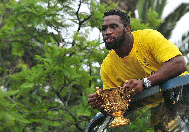IN FLUX: Springbok captain Siya Kolisi with the coveted World Cup trophy his team won in 2019. The coronavirus has had a huge impact on rugby and other global sports