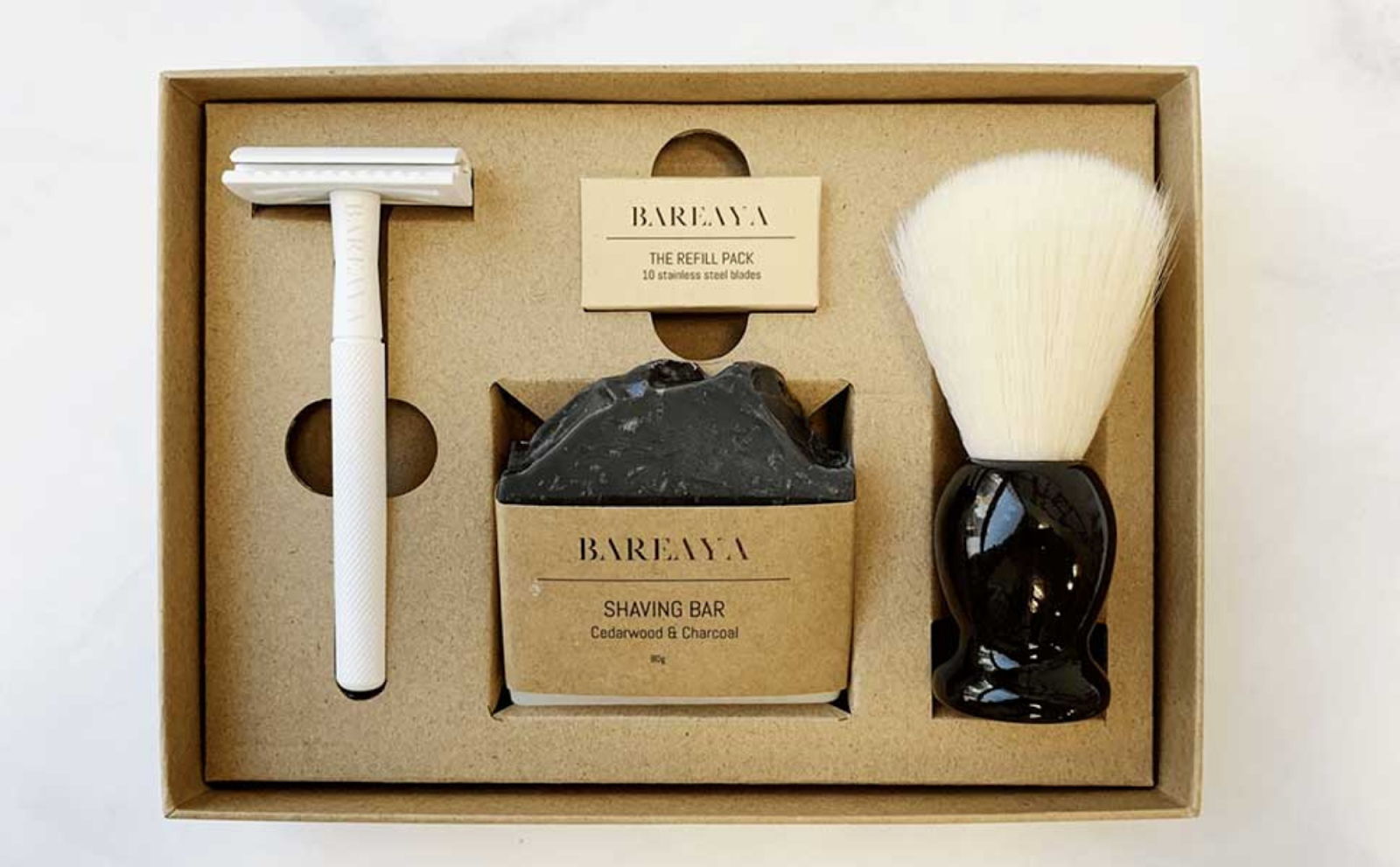 Bareaya's rigid box base with fitted insert and shaving supplies.