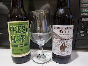 Photo: I picked up two bombers of beer today, a Fresh Hop Ale from Great Divide Brewing and a Brother David's Triple from Anderson Valley Brewing. Both beers are very good. Now to decide which one to drink. Any guesses which one I picked?