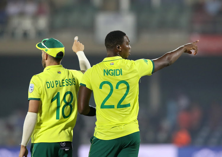 Faf Du Plessis and Lungi Ngidi of South Africa set the field during a match. Ngidi will miss the ODI series against Pakistan because of injury.