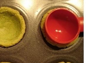 Make cookie dough. Place in greased muffin pan. Use a small icecream scoop Bake in 350...