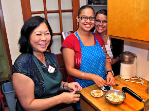 Photo: Barbara, Camille and Nichole getting herbs ready for the soup