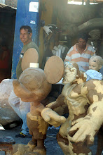 """Photo: These nice paper mache sculptures will be burned on New Year's Eve.  These are """"Old Years.""""   The poor burn effigis of an old man representing the old year, but I guess it is more fun to buy and burn a big Mickey."""