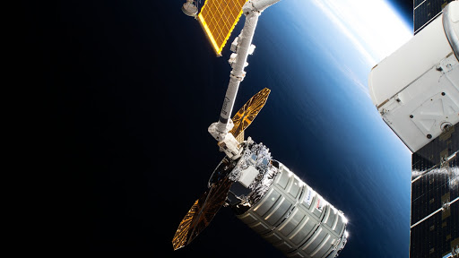 The Cygnus space freighter was pictured July 15, 2018 poised for release from the Canadarm2 robotic arm back into Earth orbit.