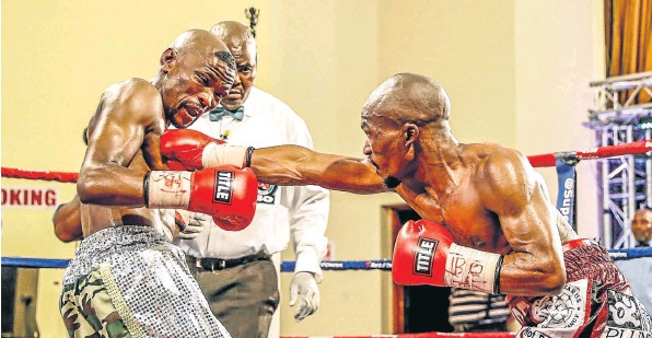 BODY BLOW: Simpiwe Konkco unleashes a straight right to Nkosinathi 'Mabere' Joyi's upper body in a recent bout .