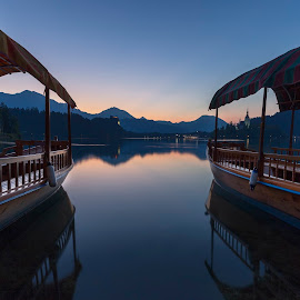 Good morning  by Bor Rojnik - Transportation Boats ( slovenia, sunrise, reflection, nature, year, bled, hiking, long exposure, water, upper carniola, summer, places, travel, day, blue hour, karavanke, landscape )